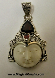 Carved Goddess Face Pendant with Triangle Garnet