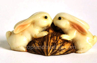 Rabbits Kissing on Walnut